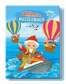 Unser Sandmännchen und seine Freunde Puzzlebuch: mit Glitzercover, 4 Puzzle 24-teilig